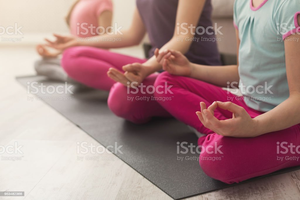 Closeup of mother and daughters hands while doing yoga stock photo