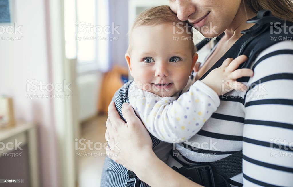 Closeup of mother holding daughter stock photo