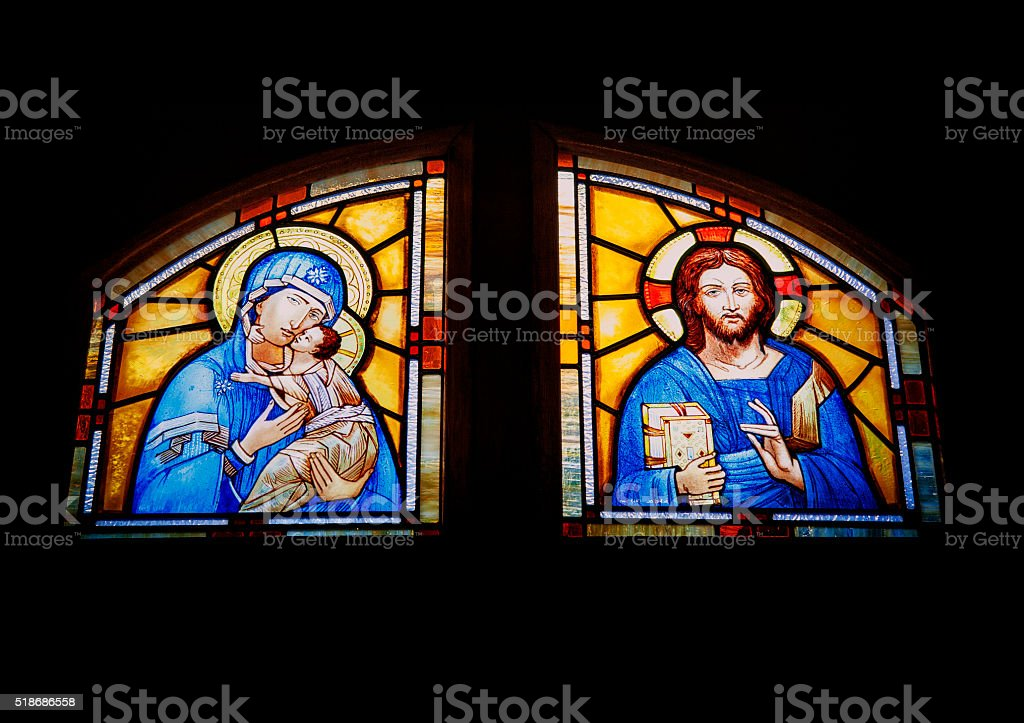 Closeup of Mother Mary and Baby Jesus and Jesus stock photo