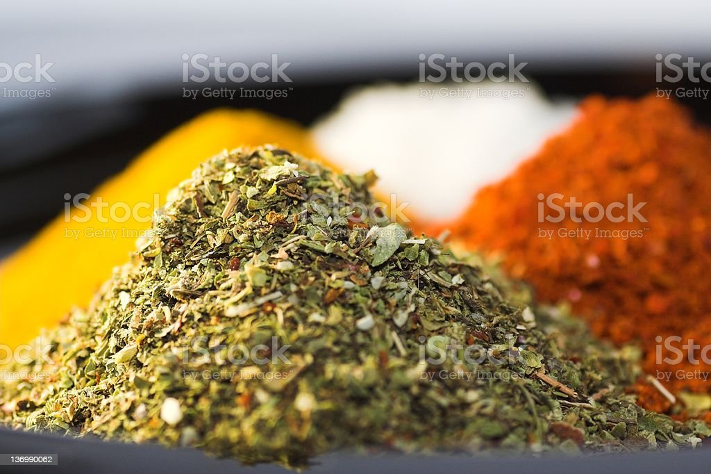 Closeup of mounds of four different spices royalty-free stock photo