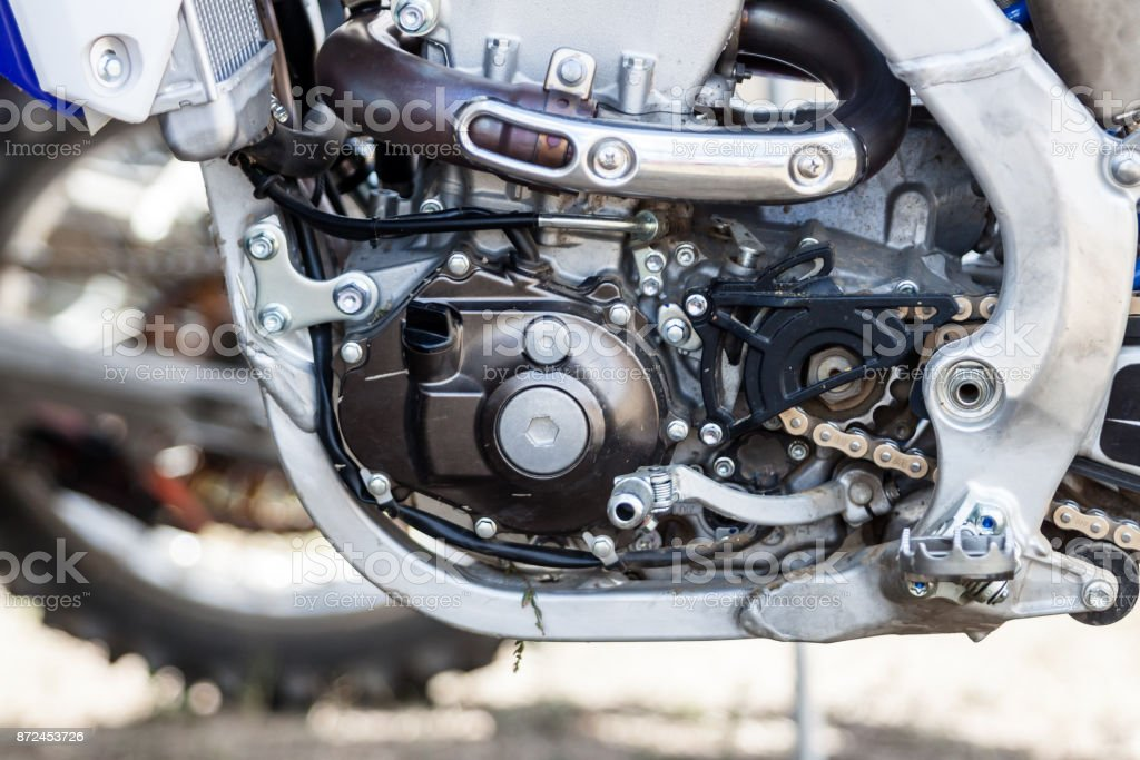 Close-up of muddy engine of dirt motorcycle stock photo