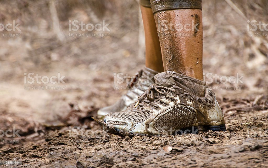 Closeup of muddy sneakers legs stock photo