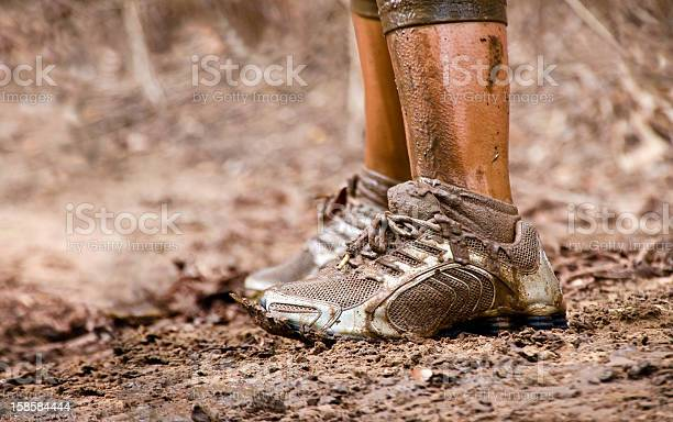 Closeup Of Muddy Sneakers Legs Stock Photo - Download Image Now