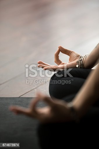 istock Closeup of mudra gesture, performed with female fingers, Padmasa 674673974