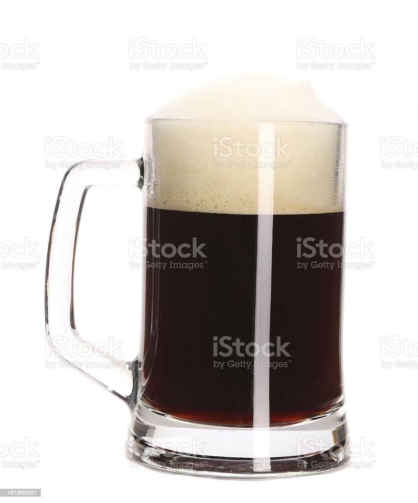 Closeup of mug full with brown beer. stock photo
