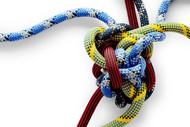 close-up of multicolored gordian knot on white background - complexity stock photos and pictures