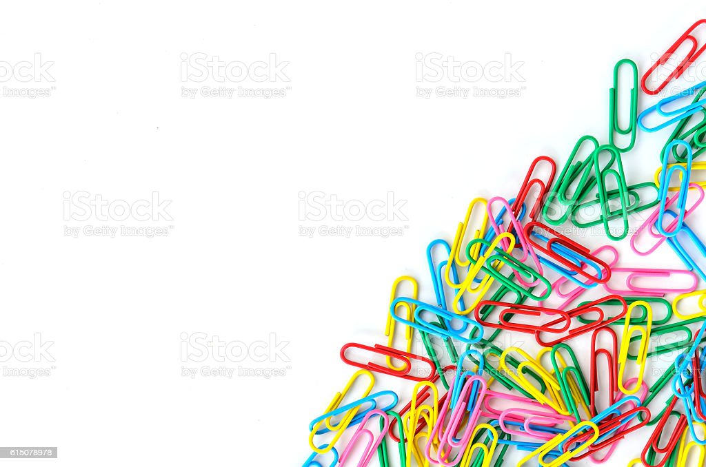 Close-up of multi-colored paper clips on a white background stock photo