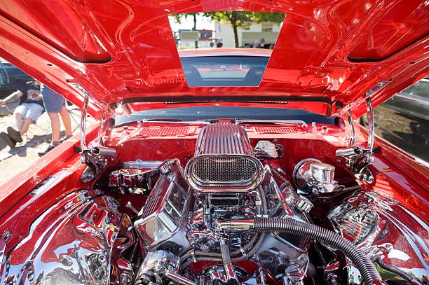 Close-up of muscle car engine compartment View at the Costumized V8 Engine of a muscle car. vehicle hood stock pictures, royalty-free photos & images
