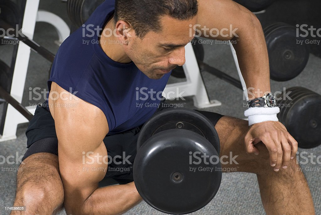 Close-up of Muscular Man Doing Biceps Curls With Heavy Dumbbell royalty-free stock photo