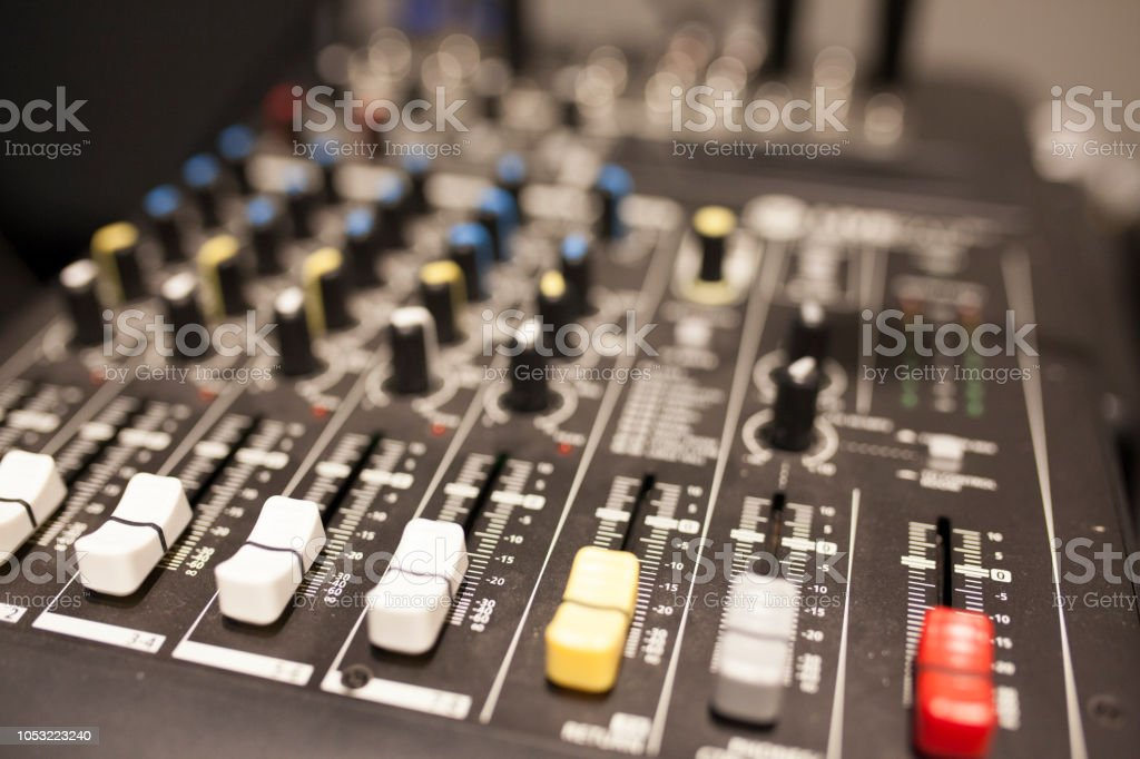 Close-up of music mixer in audio studio