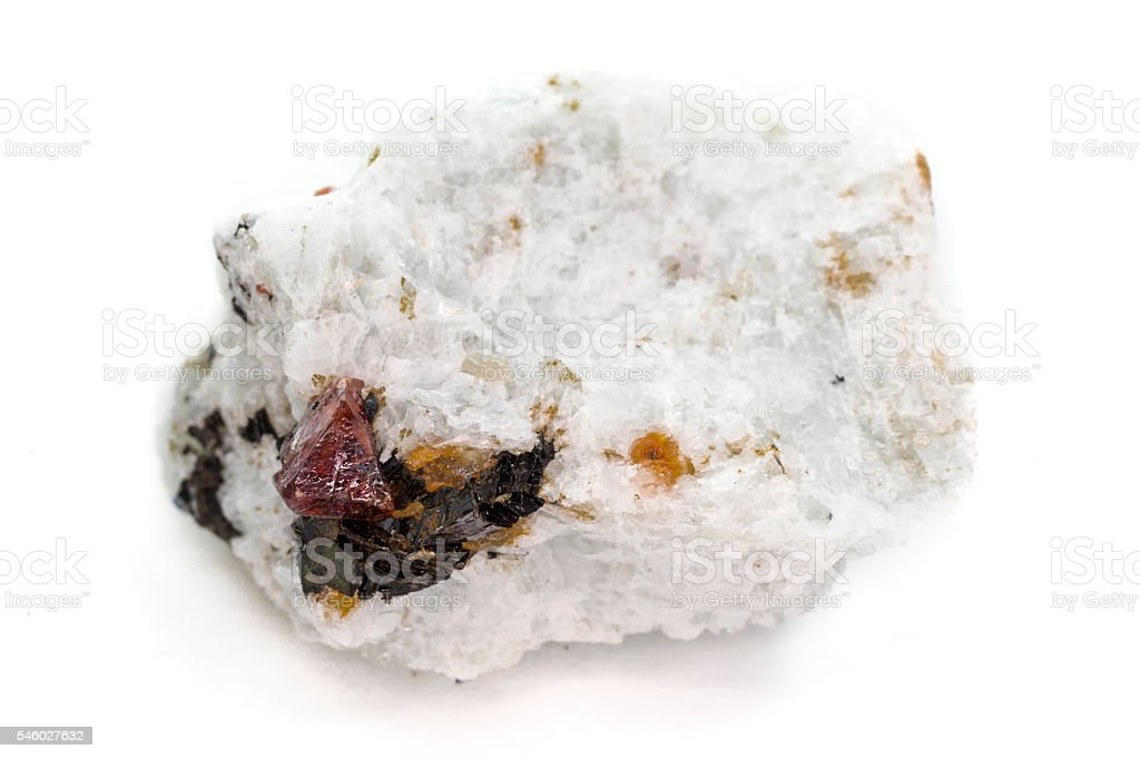 Close-up of natural mineral with red Zircon crystals stock photo