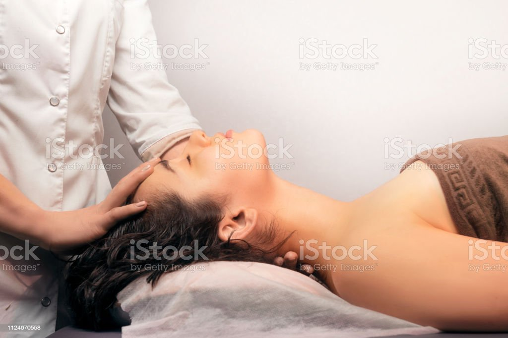 Closeup of neck massage on white background. Neck massage, neck pain...