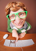 istock Close-up Of Nerdy Looking Guy Using The Computer 131472276