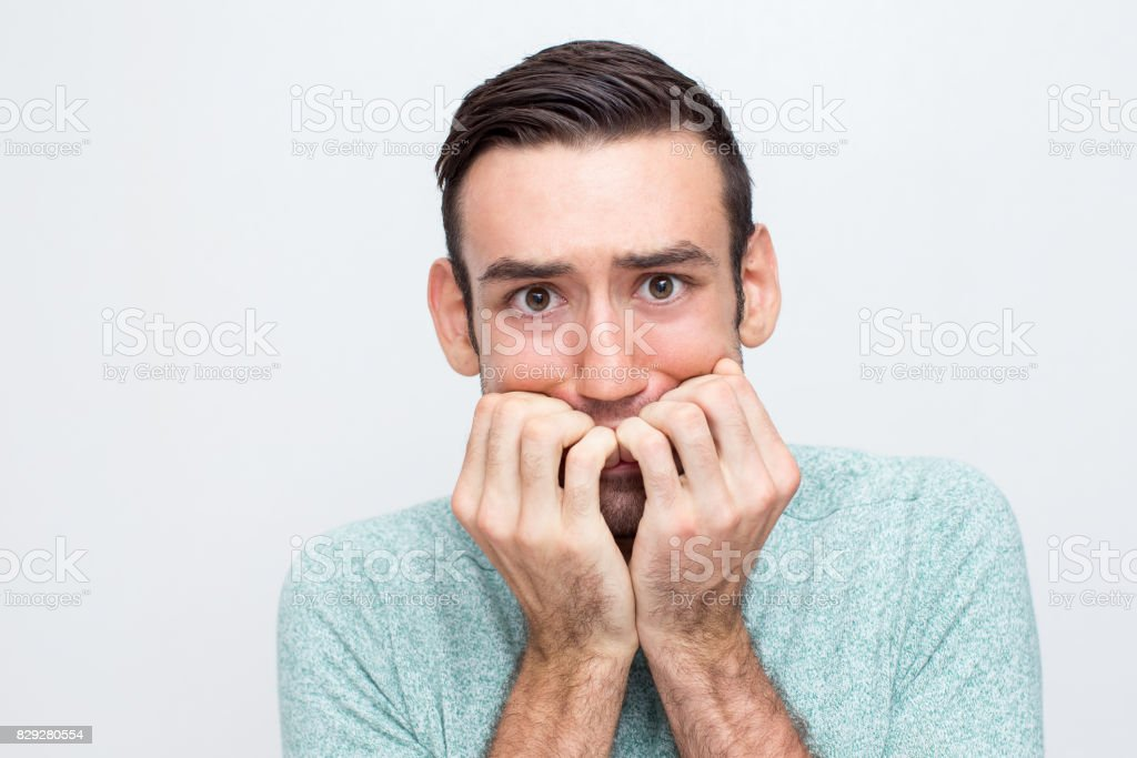 Closeup of Nervous Young Man Freaking Out stock photo