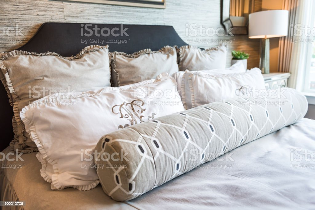 Closeup Of New Bed Comforter With Decorative Pillows In Bedroom In Staging  Model Home Apartment Or