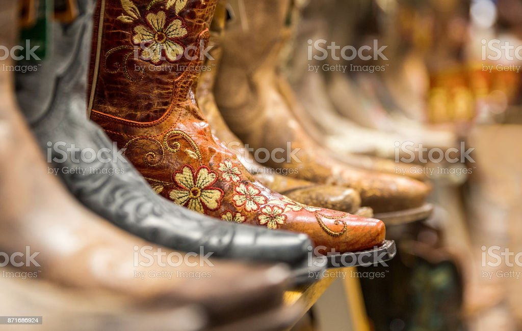 Close-up of new cowboy boots on shelf stock photo