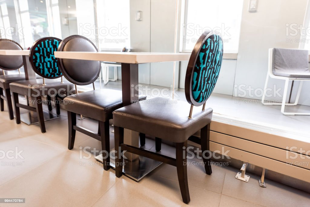 Closeup Of New Modern Blue Retro Chairs By Windows With Natural Light And Empty Table Reflection In Dining Room Restaurant Cafe Stock Photo Download Image Now Istock
