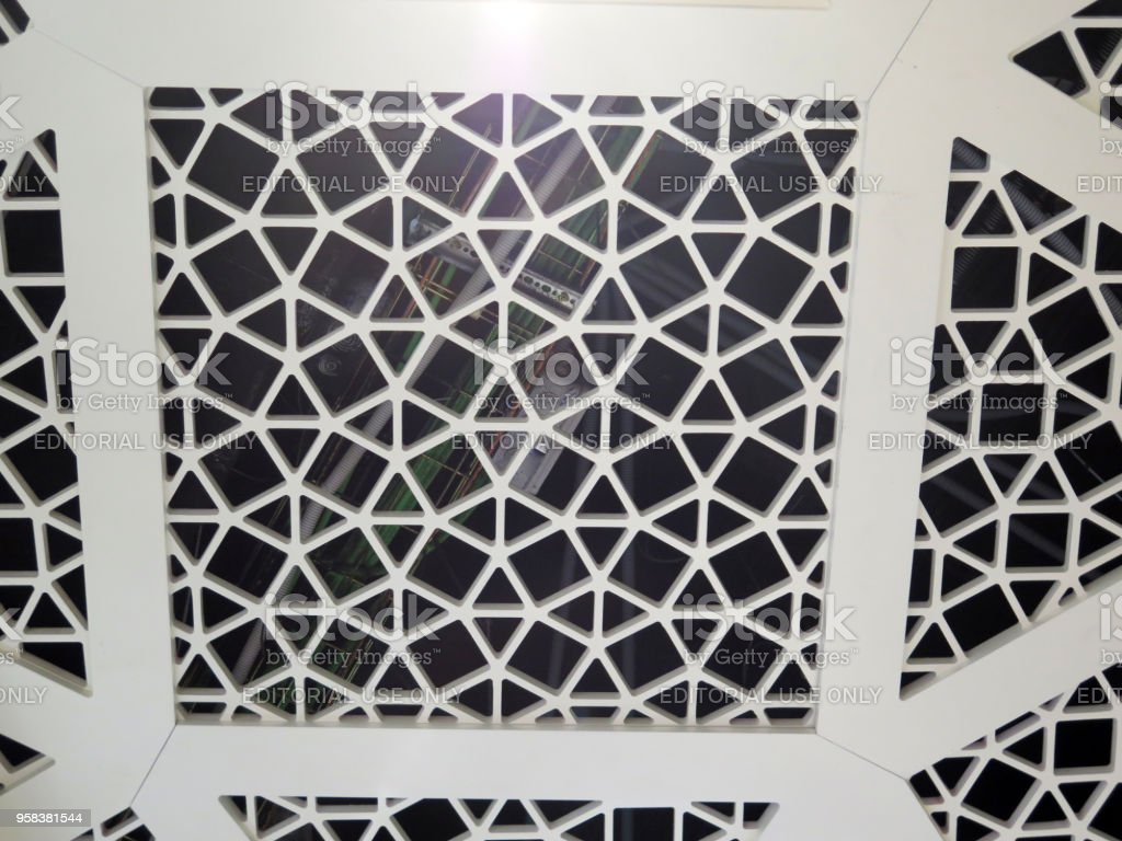 Closeup of new trellis ceiling in Malaga Airport Duty free shop, Spain stock photo