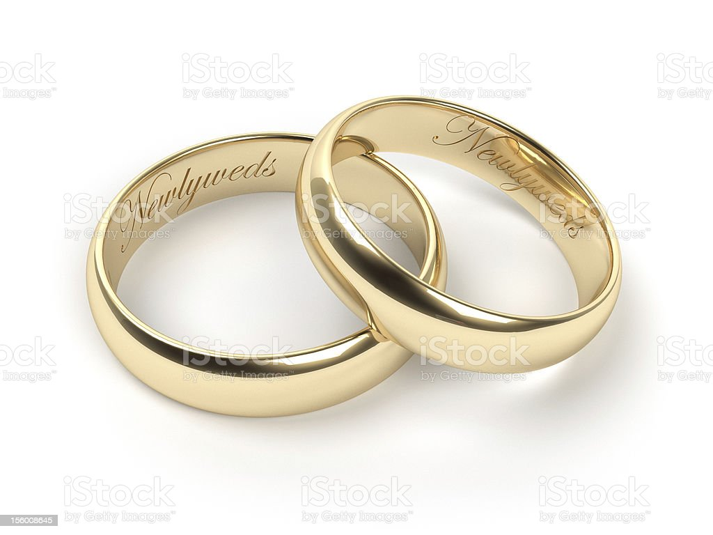 Close-up of newlywed rings on white background royalty-free stock photo