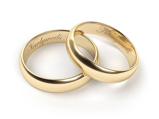 Close-up of newlywed rings on white background stock photo