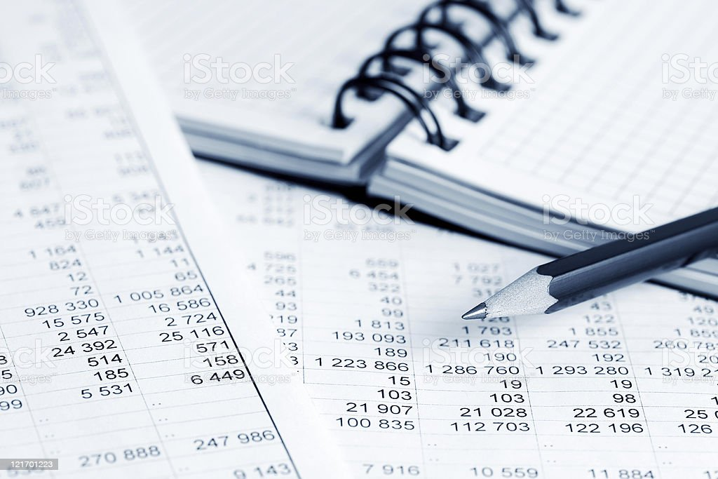 Close-up of number worksheets and notebook with black pencil stock photo