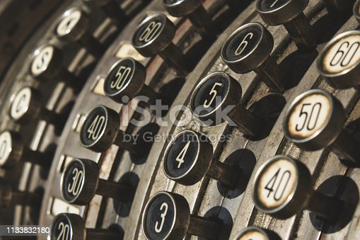 Close-up of numbered buttons on antique cash register