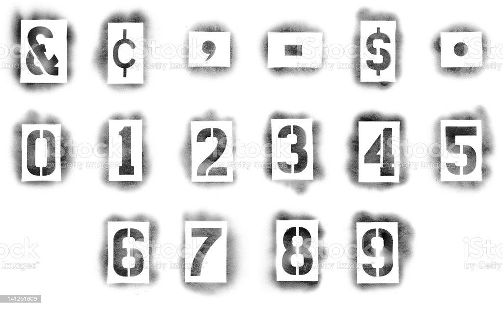 Close-up of numbers and symbols stencils in spray paint stock photo