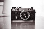 A Retro camera of classic design against a White Background/. Black and White