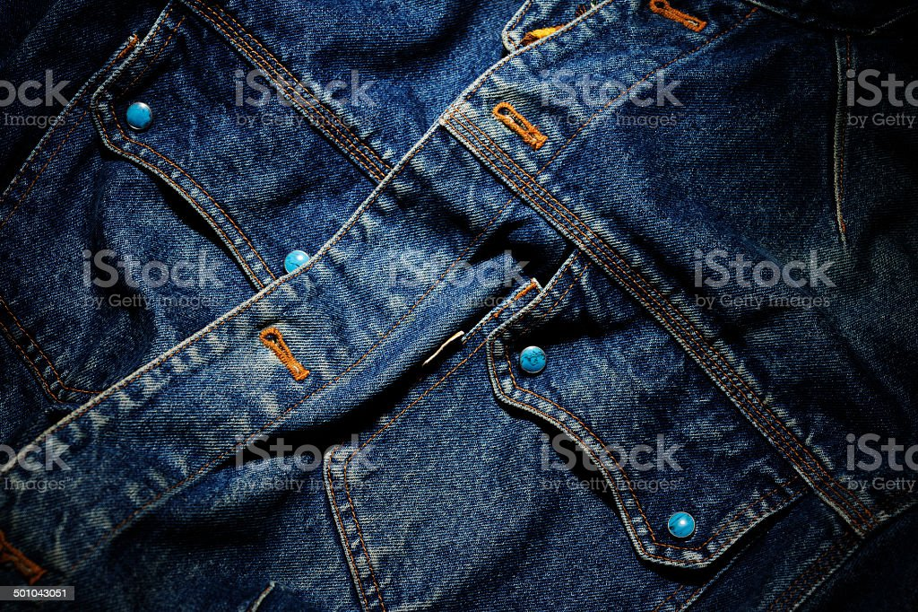 Close-up of old denim jacket with spotlight stock photo