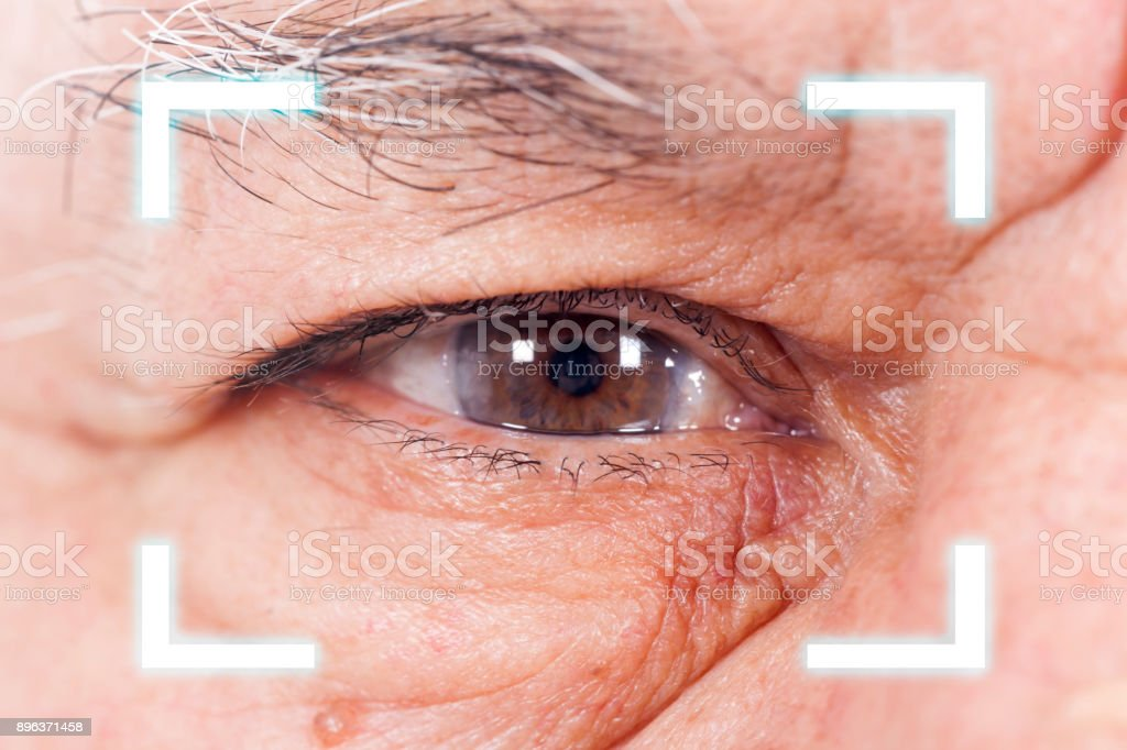 Close-up of Old Man's  eye. High Technologies in the future stock photo