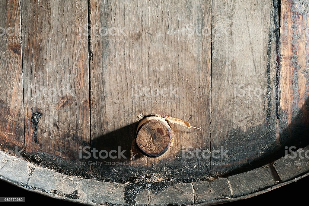 Closeup of old oak barrel. Front view. stock photo
