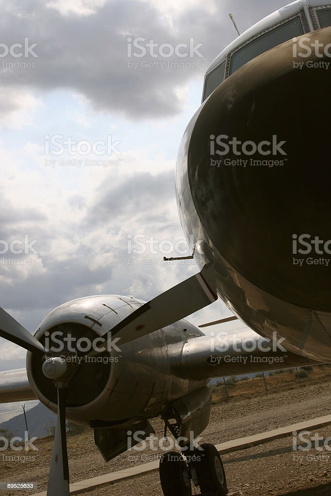 Close-up of Old Propeller Airplane in a Field royalty-free stock photo