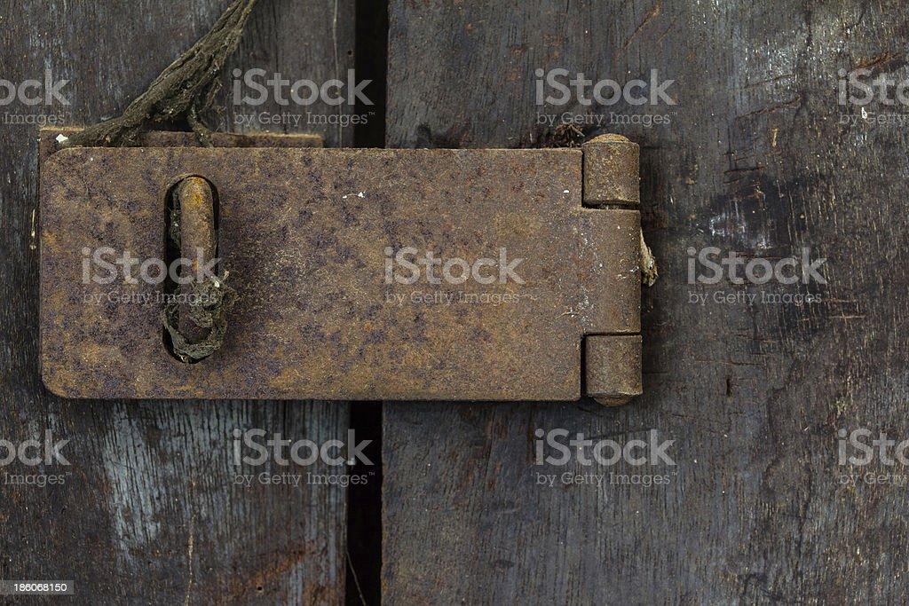 Closeup of old rusty door hinge royalty-free stock photo