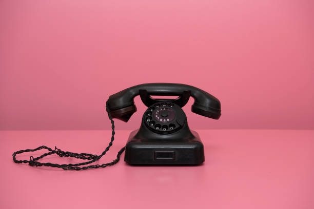 Close-Up Of Old Telephone On Pink Background stock photo