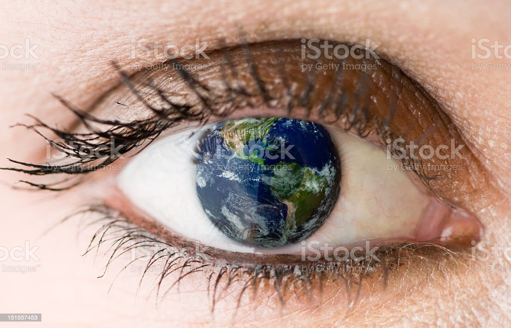 Close-up of one eye with the world as its pupil royalty-free stock photo