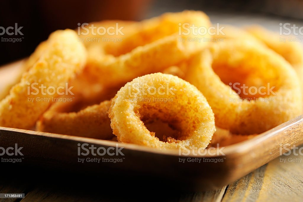 Closeup of onion rings on plate stock photo
