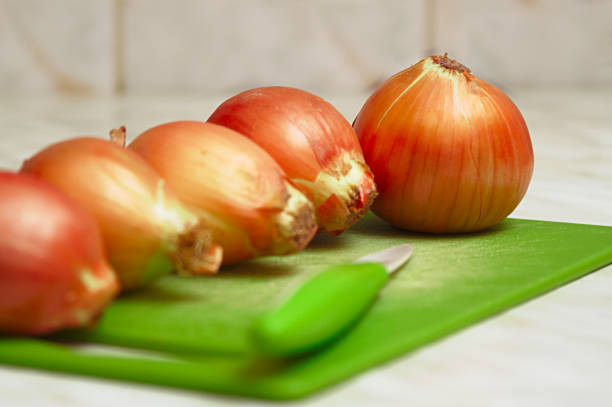 Cтоковое фото Close-up of onions on the kitchen table.