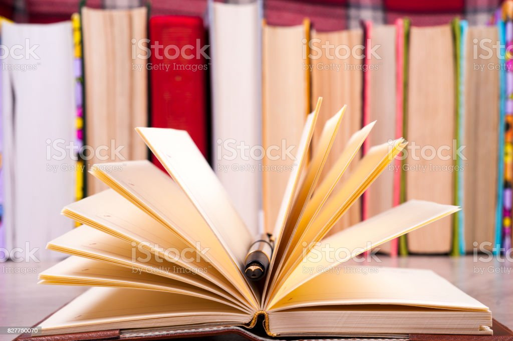 Close-up of open book and pen. Back to school stock photo