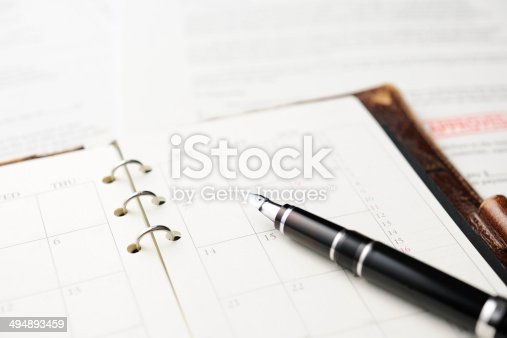 istock Close-up of opened personal organizer with Fountain Pen and document 494893459