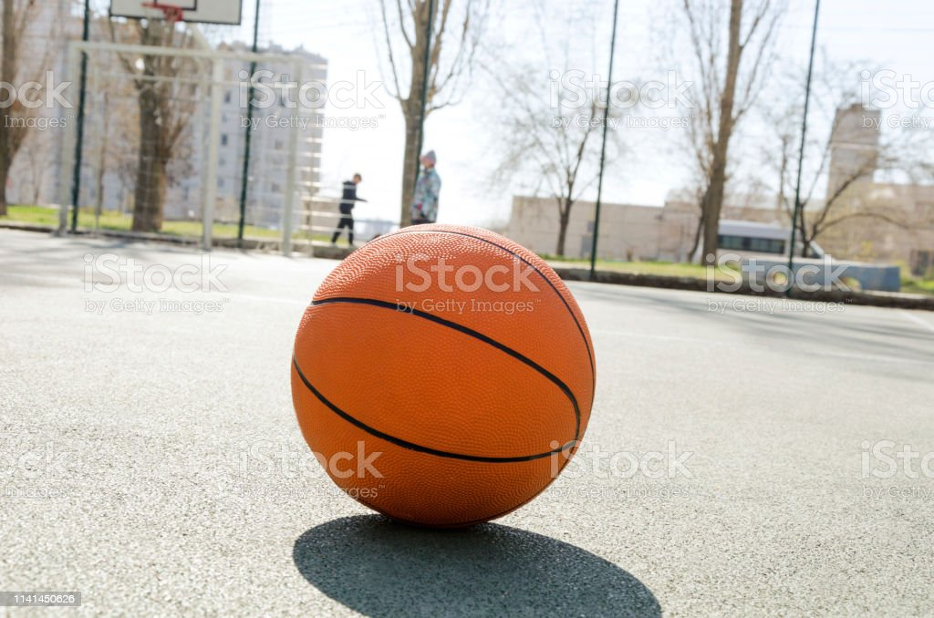 Concept of basketball game at the small sport ground outdoor.Sport...