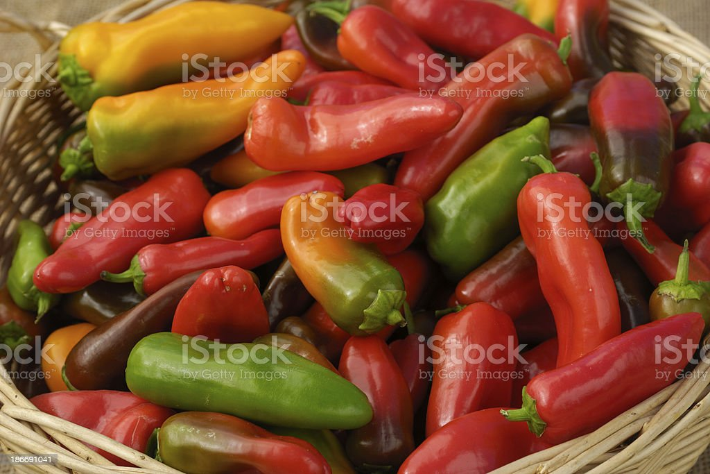 Close-up of Organic Lunch Box Peppers in Wicker Basket stock photo