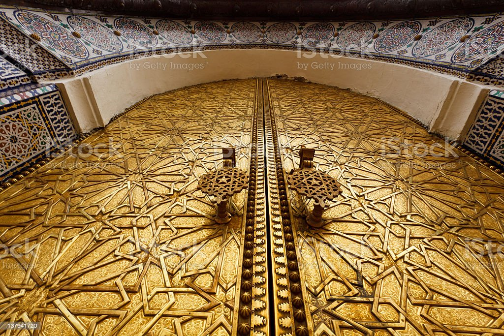 Closeup of ornate carved brass door on palace in Fez royalty-free stock photo