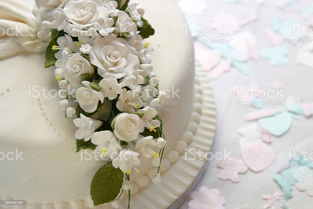 Closeup of ornate white wedding cake royalty-free stock photo