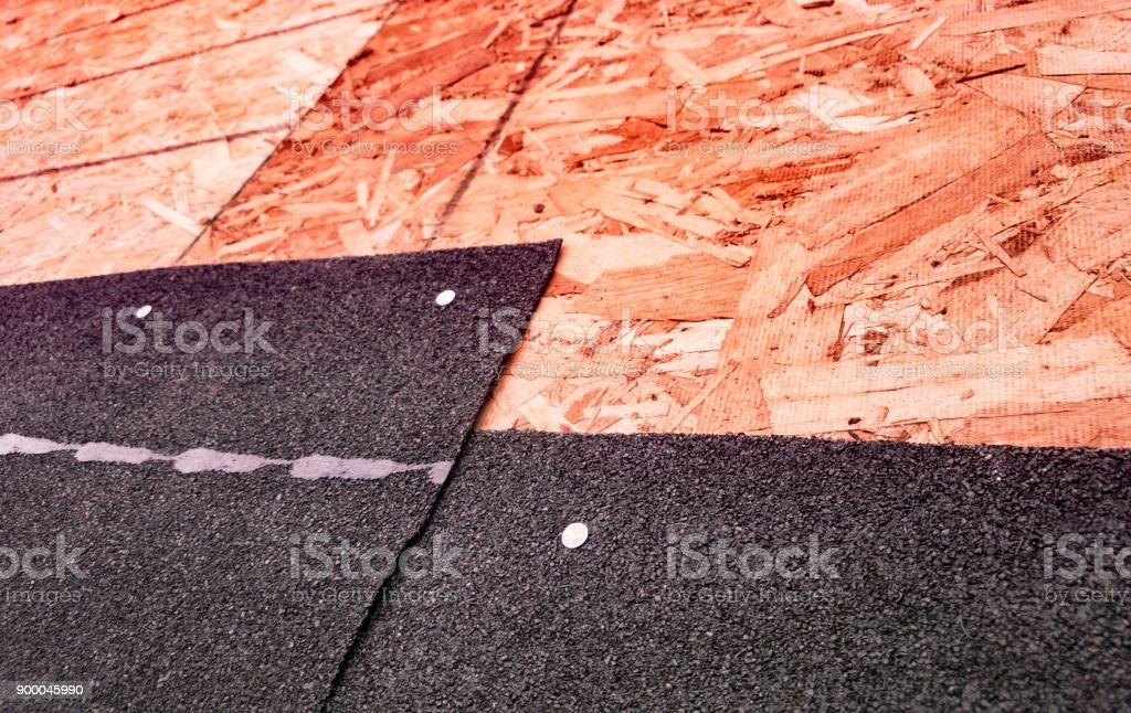 Closeup of overlapping asphalt shingles and seam stock photo