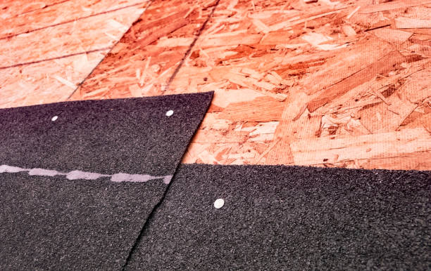 closeup of overlapping asphalt shingles and seam - seam stock photos and pictures