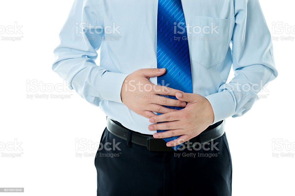 Closeup of overweight man holding his stomach photo libre de droits