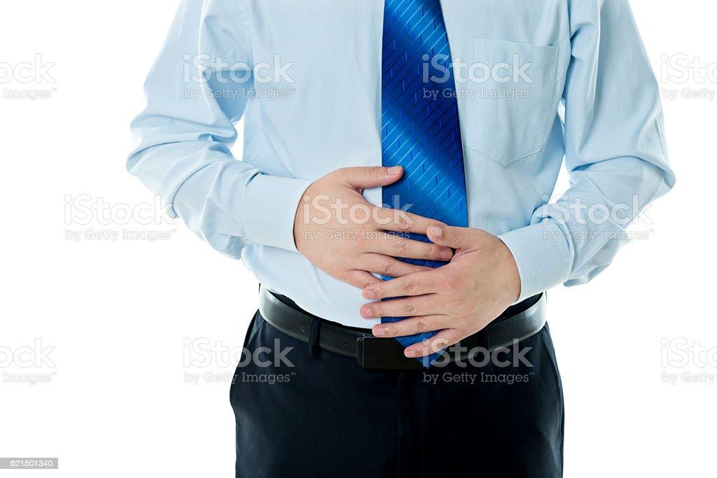 Closeup of overweight man holding his stomach Lizenzfreies stock-foto
