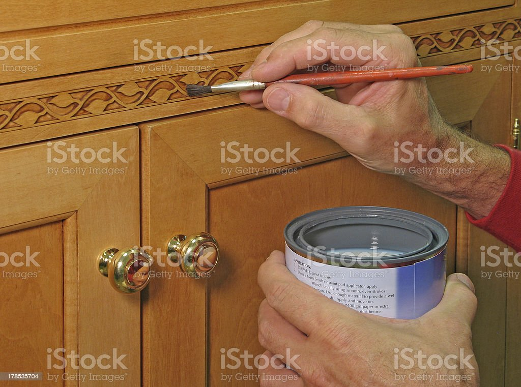 Closeup of painter apply vanish to inlaid trim - Royalty-free Accuracy Stock Photo