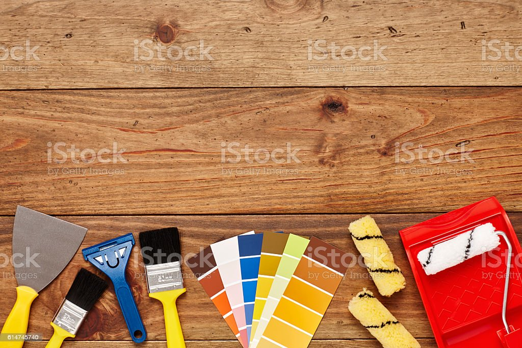 Close-up of painting tools are arranged below on wood stock photo
