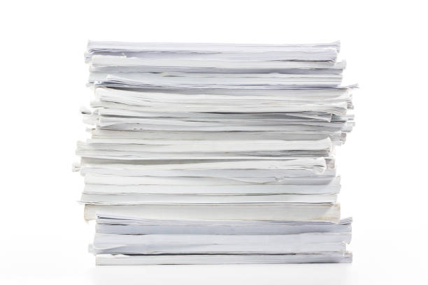 close-up of papers stack isolated on a white background - catasta foto e immagini stock